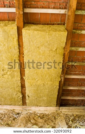thermal insulation in a roof - stock photo