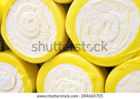 Thermal insulation material, rolls of fiberglass, rockwool, insulator, insulating glass wool, energy saving - stock photo