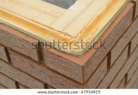 Thermal insulation of a brickwall - stock photo