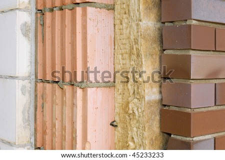 Thermal insulation of a house wall on a building site - stock photo