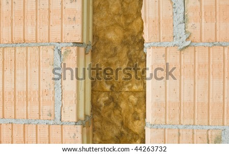 Thermal insulation of a house wall on a construction site - stock photo