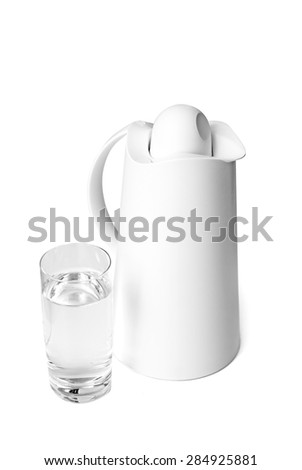 Thermal jug and a glass of water.