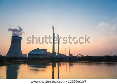 thermal power plant at dusk , industrial landscape