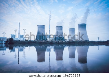 thermal power plant ,cooling towers and reflection in the river  - stock photo