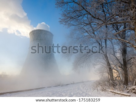 thermal power plant in winter in  fog - stock photo