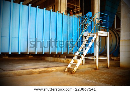 Thermal power plant workplace, large pipes and metal stairs. - stock photo
