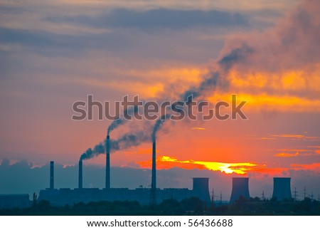 Thermal power station on a background of a sunset - stock photo