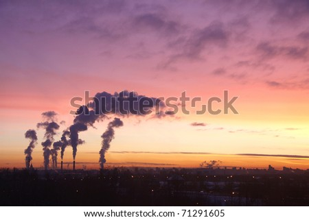 Thermoelectric station generanting smokes at the sunset - stock photo