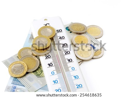 thermometer and money isolated on white background, concept for rising energy costs in homes - stock photo