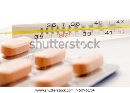 thermometer and pills picture closeup - stock photo