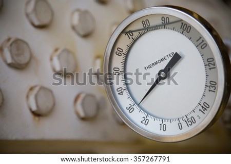thermometer gauge in production process and measuring temperature, electronic equipment and sent signal to controller, machine equipment in industry job.