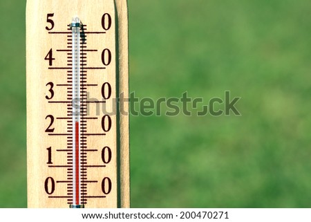 Thermometer on natural background
