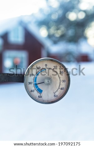 Thermometer on window, close-up - stock photo