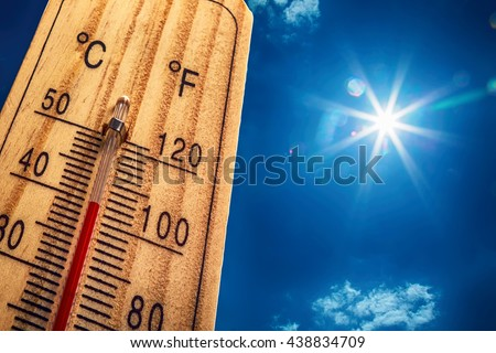 Thermometer Sun Sky 40 Degrees. Hot summer day. High temperatures in degrees Celsius and farenheit.
