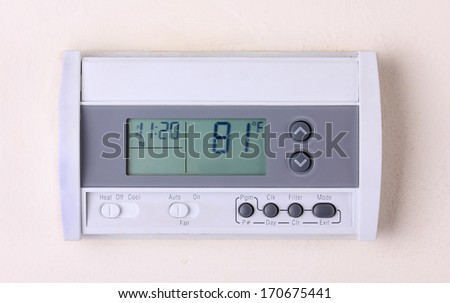 thermostat  digital Programmable on wall - stock photo