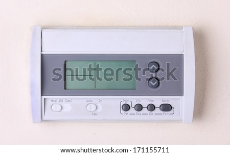 thermostat turn off digital Programmable on wall  - stock photo