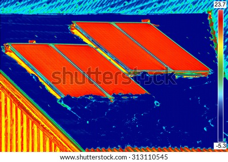 Thermovision image of Photovoltaic Solar Panels on the roof House - stock photo