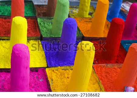 These are colored paints for sale in an Indian market. - stock photo