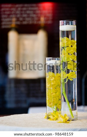 these are yellow orchids floating in water. used as decoration during a wedding - stock photo