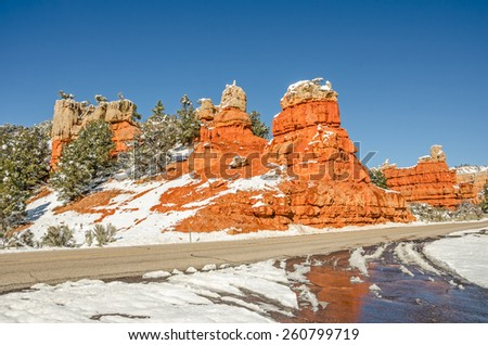 These beautiful rock formations mark the west entrance to Red Canyon on Scenic Byway 12 in Utah.  - stock photo