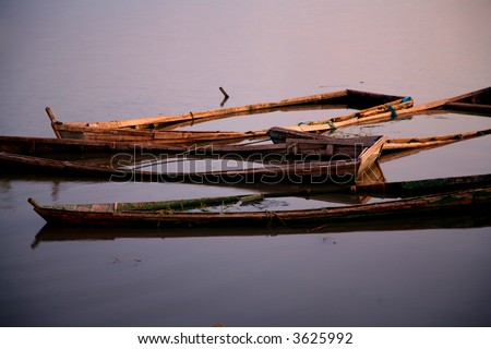 these dugouts/ canoes sank in the lake Chiurre in Malawi. No more used fore fishing. - stock photo