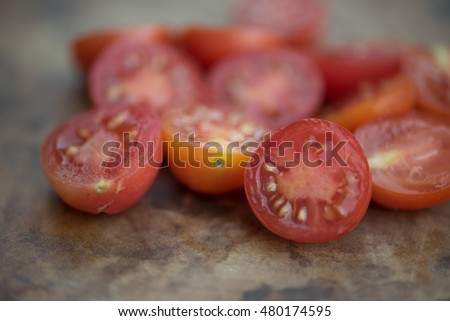These home grown sliced Matt's Wild Cherry Tomatoes are part of the species Lycopersicum esculentum.  Originally from Maine this species is very popular for garden growing in the summertime.