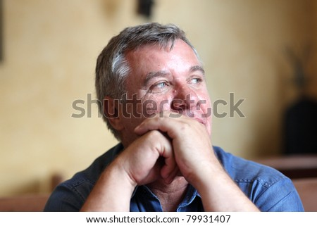 These is portrait of the thoughtful man indoor - stock photo