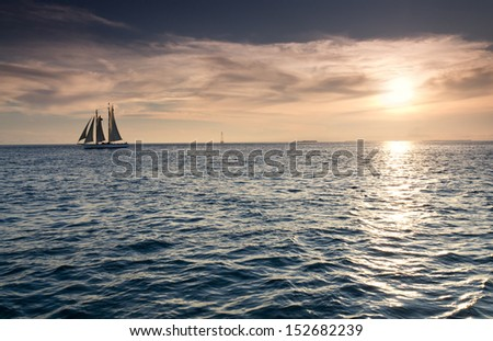 These sail boats take quiet advantage of the beautiful sunsets in Key West Florida during a sunset cruise. The colors in the sky and ocean abound.