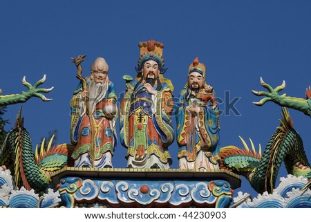 These three men are on a lot of Chinese temples, certainly in Taiwan. Besides them are the claws of dragons. - stock photo