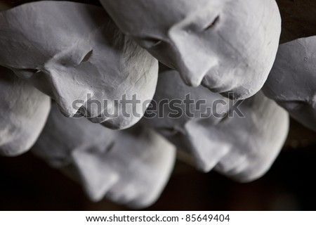 These White Masks selling in the theatre for children to painting. Actually, the actors use it in the performance as well. - stock photo