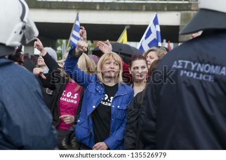 THESSALONIKI,GREECE-APR,14:Demonstrators shout slogans outside the police station during a protest against the arrest of residents for attacking a Canadian Eldorado Gold,in Thessaloniki,14 April 2013 - stock photo