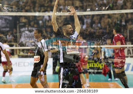 THESSALONIKI, GREECE, APRIL 23, 2015: Double exposure of Pantakidis during the Hellenic Volleyball League final games Paok vs Olympiacos at PAOK Sports Arena. - stock photo