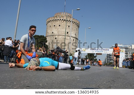 THESSALONIKI, GREECE - APRIL 21:Egyptian BAYOUMI HATEM marathon runner fades out after finishing  on 8th Marathon Alexander the Great on April 21,2013 in Thessaloniki, Greece - stock photo