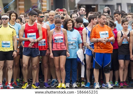 THESSALONIKI, GREECE - APRIL 6, 2014 : Runners standing in the starting line during the 9th Marathon Alexander the Great. The marathon is an annual event. - stock photo
