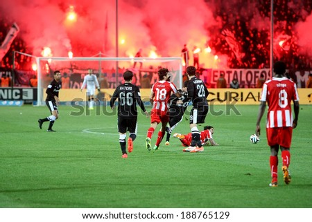 THESSALONIKI, GREECE APRIL 16, 2014 : The players of Paok in action with the players of Olympiacos during the Greek Cup Semi Final match PAOK vs Olympiacos