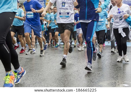 THESSALONIKI, GREECE - APRIL 6, 2014 : Unidentified people running during the 9th Marathon Alexander the Great. The marathon is an annual event. - stock photo