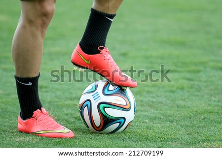 THESSALONIKI, GREECE- AUGUST 14 : Footballer's feet in action with a ball before the friendly match Paok vs Inter.