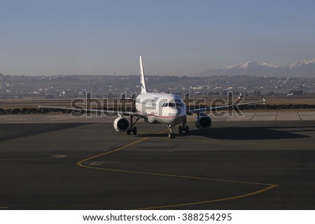 Thessaloniki, Greece - February 9, 2016. Aegean Airlines Airbus A320 on the tarmac going to park after landing in Makedonia International Airport. Olympus mountain on the background