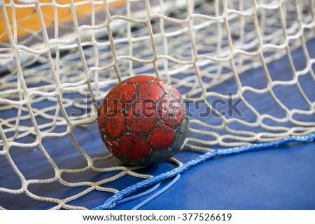 Thessaloniki, Greece - February 13, 2016: Handball ball on the goalpost net prior to the Greek Women Cup Final handball game Arta vs Nea Ionia - stock photo