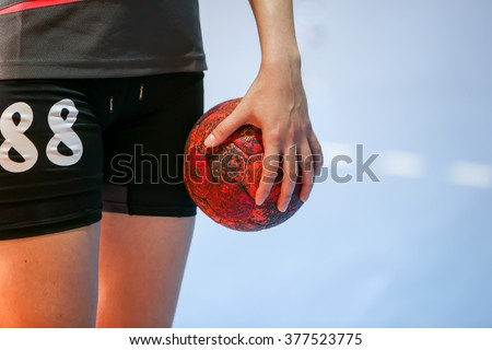 Thessaloniki, Greece - February 13, 2016: Undefined hands holding a ball prior to the Greek Women Cup Final handball game Arta vs Nea Ionia - stock photo
