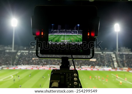 THESSALONIKI, GREECE FEBRUARY 8, 2015 : View of the full stadium behind the TV media broadcasting during the Greek Superleague match PAOK vs Olympiacos - stock photo