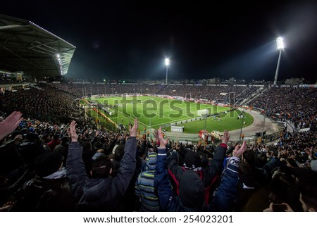 THESSALONIKI, GREECE FEBRUARY 8, 2015 : View of the Toumba Stadium full of fans and supporters of PAOK who light flares during the Greek Superleague match PAOK vs Olympiacos - stock photo