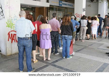 THESSALONIKI, GREECE,JUN 27 2015: People stand in a queue to use the ATMs of a bank. Greece's fraught bailout talks with its creditors took a dramatic turn, with the government announcing a referendum - stock photo