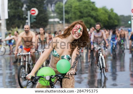 THESSALONIKI, GREECE - JUNE 5, 2015: 8th World Naked Bike Ride. Hundreds of cyclists either naked or half naked demanding a more sustainable Thessaloniki to mobility and cycling. - stock photo