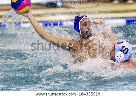 THESSALONIKI, GREECE MAR 22, 2014 : The players of the two teams in action during the Greek League water polo game PAOK vs Vouliagmeni on March 22, 2014.