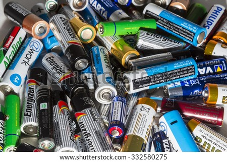 Thessaloniki, Greece- March 26, 2015: Different types of used batteries ready for recycling lying in a heap at a recycling center in Thessaloniki, Greece. - stock photo