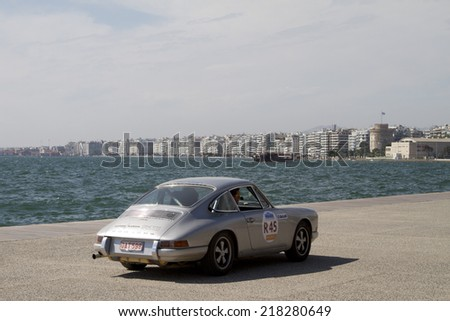 THESSALONIKI, GREECE- MAY 13, 2014: Participants of the rally Tour Amical in their car. A Classic Car Rally, in Thessaloniki, Greece. - stock photo