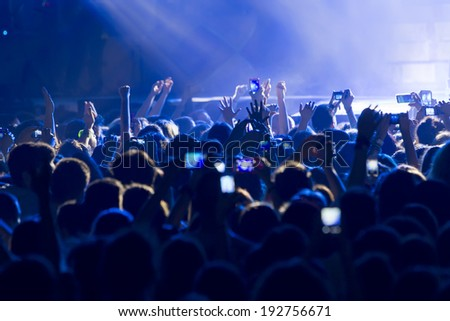 THESSALONIKI, GREECE, MAY 8 2014:People taking photographs with touch smart phone during a music concert live on stage for the Ace of Heart tour at Sports arena in Thessaloniki.