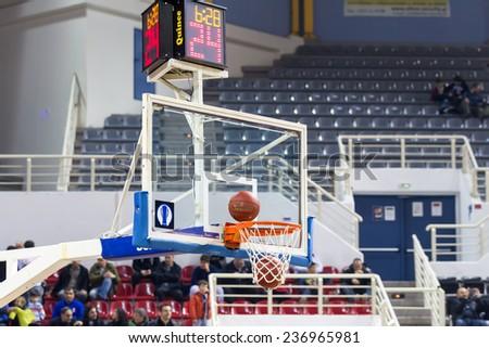 THESSALONIKI, GREECE - NOV 12, 2014: Basketball ball going through the net prior to Eurocup game Paok vs Buducnost - stock photo
