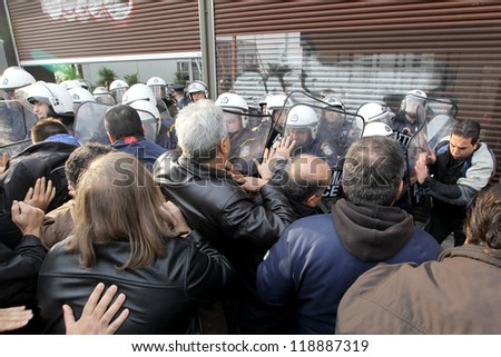 THESSALONIKI,GREECE-NOV,15:Municipal workers clash with riot police during a demonstration against the presence of German Deputy Labor minister Hans-Joachim Fuchtel in Thessaloniki 15 November,2012 - stock photo